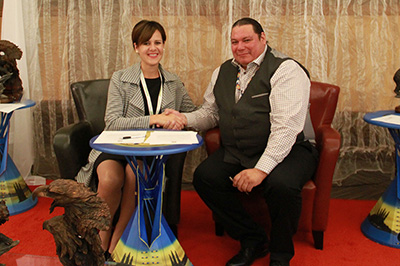 Hatch Indigenous Engagement Director, Chelsie Klassen signing a MOU with SFNSA, CEO, Toby Desnomie