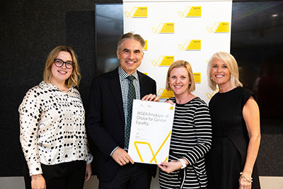 Hatch receives the Employer of Choice for Gender Equality accreditation from Libby Lyons, director of the Workplace Gender Equality Agency. From left, Catherine Robinson, Jan Kwak, and Rowena Gamble from Hatch with Libby Lyons, WGEA.