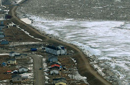 A stabilizing berm holds off ice and water from overflowing into the Kashechewan First Nation thumbnail